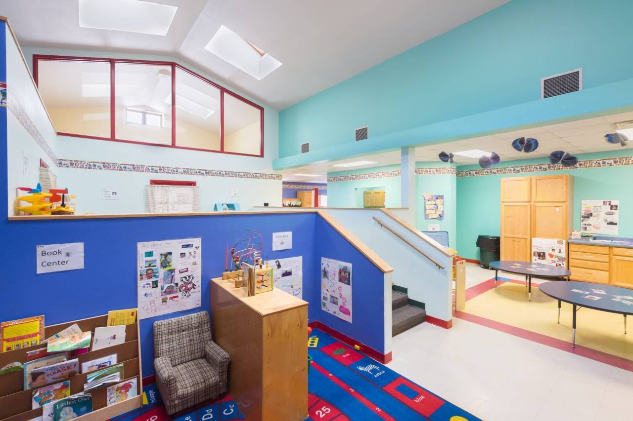 daycare space with vaulted ceiling and half wall dividers